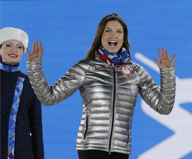 Women's super combined bronze medalist Julia Mancuso of the United States waves during the medals ceremony at the 2014 Winter Olympics, Monday, Feb. 10, 2014, in Sochi, Russia. (AP Photo/Morry Gash)