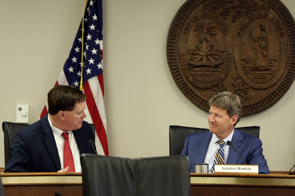 House Speaker Jay Lucas, R-Hartsville, left, talks to Senate Judiciary Chairman Luke Rankin, R-Myrtle Beach, right, during a meeting over a Santee Cooper overhaul bill on Tuesday, June, 1, 2021, in Columbia, S.C. Powerful legislative leaders reached a compromise on the bill that will be considered at a special session. (AP Photo/Jeffrey Collins)