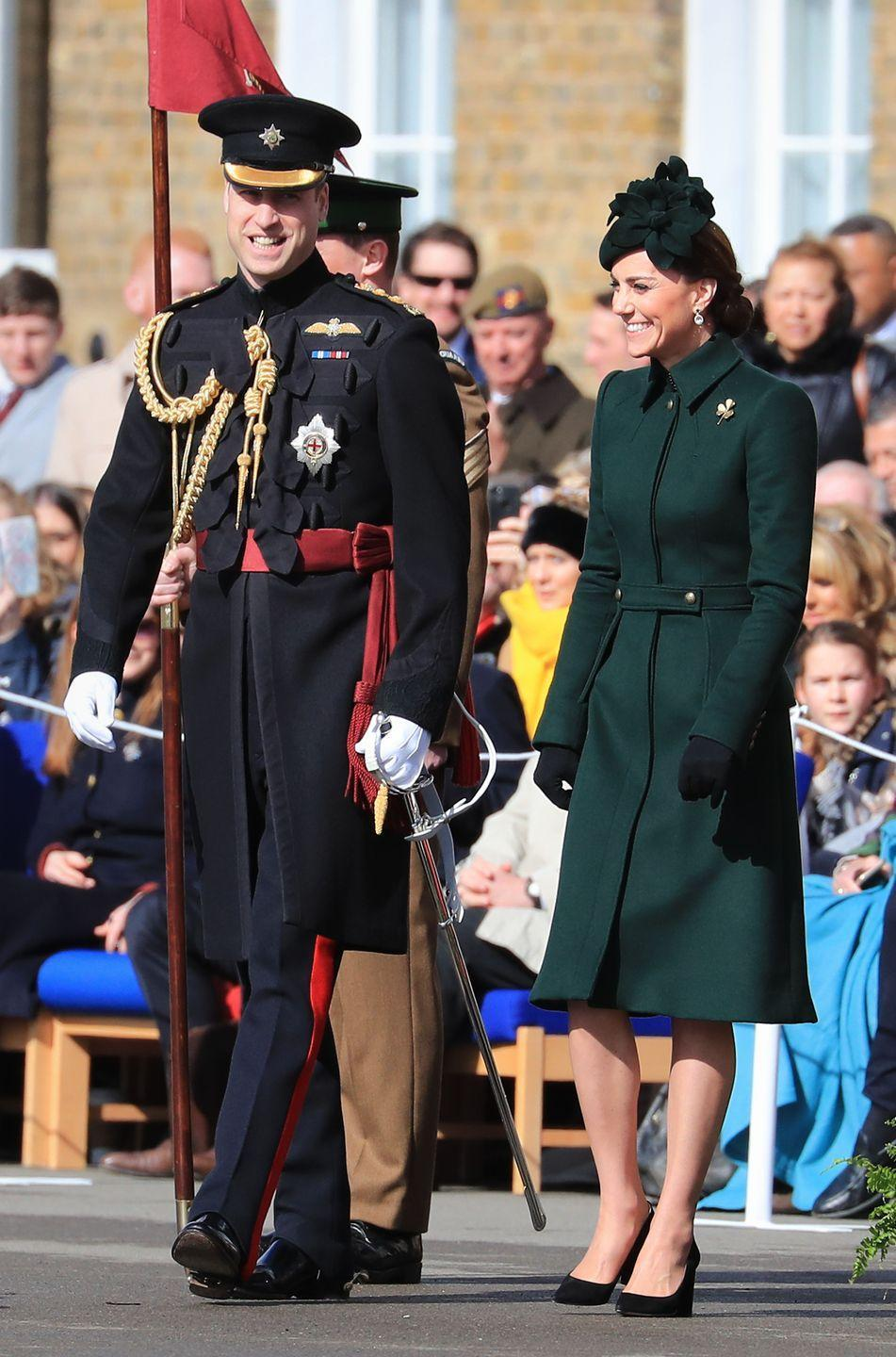 "<p>For her annual St. Patrick's Day visit to the Irish Guards, Kate Middleton wore a dark green Alexander McQueen coat, Kiki McDonough green tourmaline and amethyst drop earrings, a green fascinator, and the <a href=""https://www.townandcountrymag.com/style/jewelry-and-watches/a26799974/kate-middleton-gold-shamrock-brooch-history/"" rel=""nofollow noopener"" target=""_blank"" data-ylk=""slk:traditional gold Shamrock brooch"" class=""link rapid-noclick-resp"">traditional gold Shamrock brooch</a>. </p>"