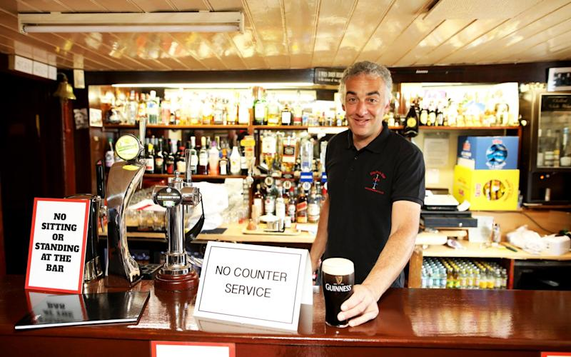 John Frances, owner of The Maypole Bar in Holywood, Northern Ireland, which had reopened on Sept 23 - Peter Morrison