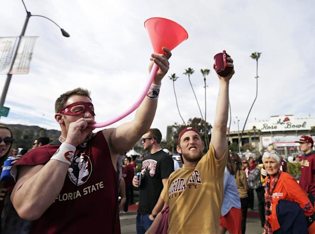 Josh Harness, left, and Sam Houston drink outside the Rose Bowl before the NCAA BCS National Championship college football game between Auburn and Florida State Monday, Jan. 6, 2014, in Pasadena, Calif. (AP Photo/Gregory Bull)