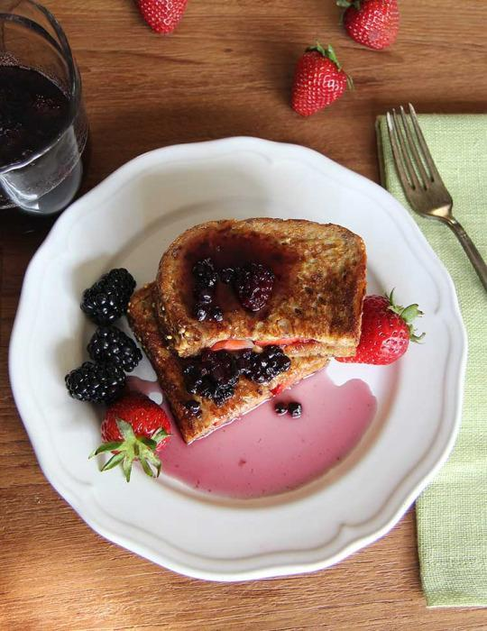 Peanut butter and jelly french toast recipe from hilah cooking below hilah johnson of hilah cooking shares what might be the most decadent french toast ever with a peanut butter and jelly sandwich seriously ccuart Image collections