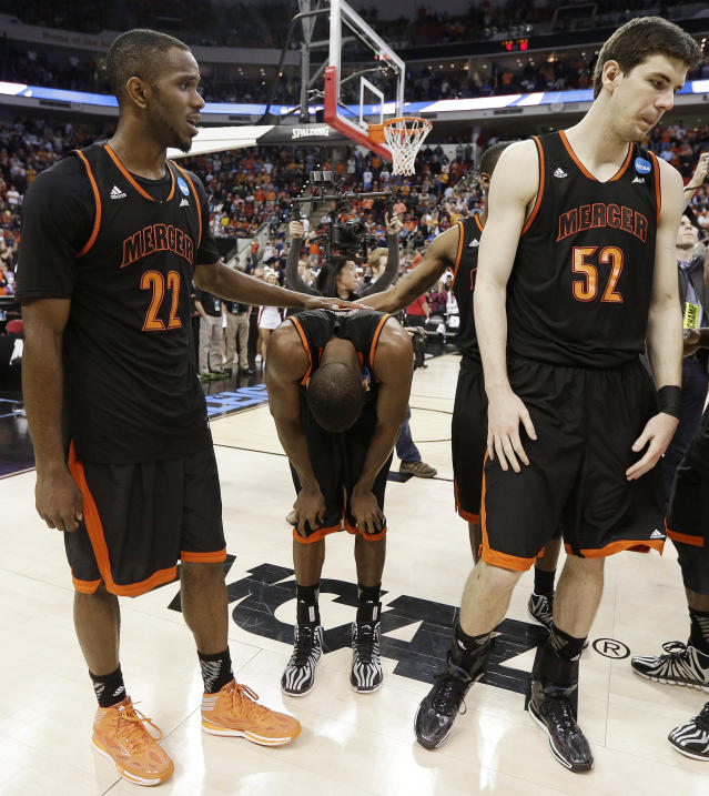Mercer guard Langston Hall, center, stands with his teammates after the second half of an NCAA college basketball third-round tournament game against Tennessee, Sunday, March 23, 2014, in Raleigh. Tennessee Won 83-63. (AP Photo/Chuck Burton)