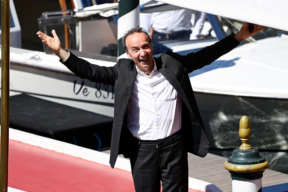<p>Roberto Benigni looked thrilled to be back at the Venice Film Festival. The Italian actor smiled big and threw his arms open as he arrived on Sept. 1.</p>