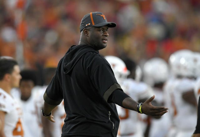 Former Texas quarterback Vince Young stands on the sidelines during the first half of an NCAA college football game between Southern California and Texas, Saturday, Sept. 16, 2017, in Los Angeles. (AP Photo/Mark J. Terrill)