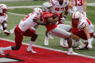Ohio State running back Master Teague, right, spins into the end zone against Nebraska defensive back Marquel Dismuke during the first half of an NCAA college football game Saturday, Oct. 24, 2020, in Columbus, Ohio. (AP Photo/Jay LaPrete)