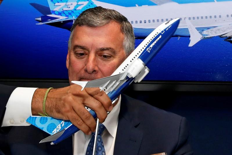 FILE PHOTO: A model of a Boeing 737 MAX is held in front of Kevin McAllister at Le Bourget Airport