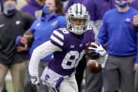 Kansas State wide receiver Phillip Brooks returns a punt for a touchdown during the first half of an NCAA football game against Kansas Saturday, Oct. 24, 2020, in Manhattan, Kan. (AP Photo/Charlie Riedel)