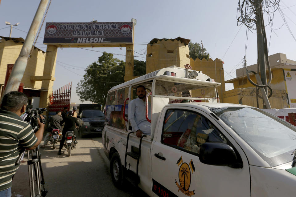 Police vehicles are driven out from the Karachi Central Prison where British-born Pakistani Ahmed Omar Saeed Sheikh, who was charged, convicted and later acquitted in the 2002 murder of American journalist Daniel Pearl is detained, in Karachi, Pakistan, Friday, Jan. 29, 2021. Pakistan is scrambling to manage the fallout of a Supreme Court decision to free the Pakistani-British man accused in the 2002 beheading of American Journalist Daniel Pearl. The Sindh Provincial government on Friday filed a review petition, asking the same court to revisit its decision. (AP Photo/Fareed Khan)