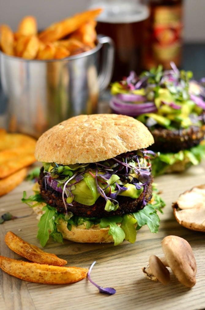 "<p>Mushroom-lovers will go wild for these rich and hearty burgers. They pair well with arugula, sprouts, and fries, so eat up! </p> <p><strong>Get the recipe</strong>: <a href=""https://hostthetoast.com/umami-bomb-mushroom-burgers/"" class=""link rapid-noclick-resp"" rel=""nofollow noopener"" target=""_blank"" data-ylk=""slk:umami bomb mushroom burgers"">umami bomb mushroom burgers</a></p>"