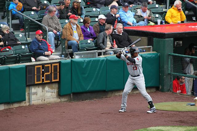 Rochester Red Wings batter Argenis Diaz (13) swings in the on-deck area as a 20-second pitch clock is used during the Triple-A baseball opener between the Buffalo Bisons and Rochester Red Wings in Buffalo, N.Y., Thursday, April 9, 2015. (AP Photo/Bill Wippert)