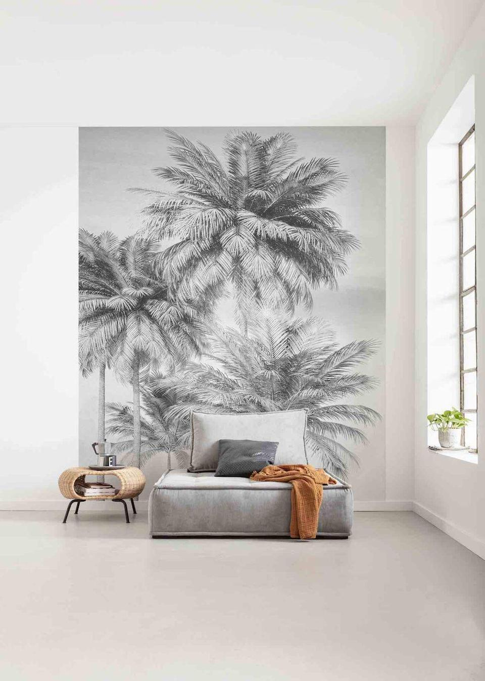 """<p>In a big open area like a loft-style living room, zone the space with a huge mural. Although it's large, it's quite calming due to the grey and white monochrome palette and simple design – it looks like a painting.</p><p>Top Tip: Murals are so versatile as they can be made to any size. </p><p>Pictured: Miami Palms Mural Wallpaper, <a href=""""https://www.foresthomesstore.com/products/miami-palms-mural-wallpaper"""" rel=""""nofollow noopener"""" target=""""_blank"""" data-ylk=""""slk:Forest Homes"""" class=""""link rapid-noclick-resp"""">Forest Homes</a></p>"""