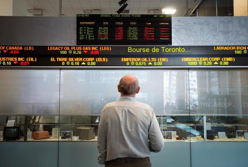 Toronto stock index rises with U.S. markets, loonie falls on poor jobs report