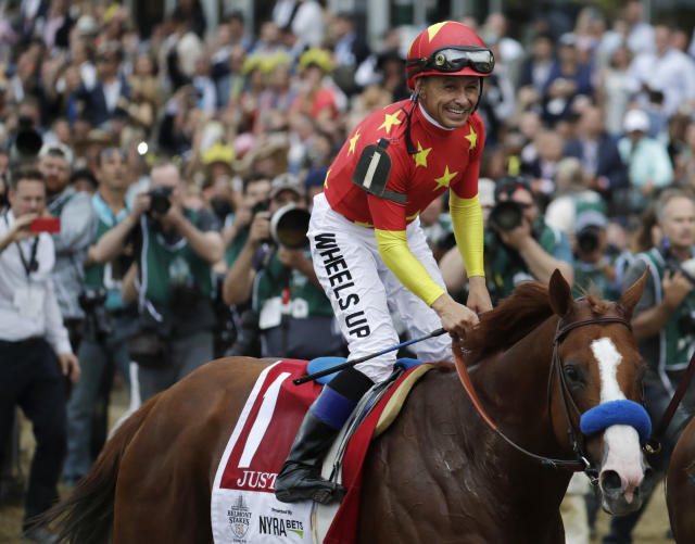 FILE - In this June 9, 2018, file photo, Jockey Mike Smith smiles after guiding Justify to the win in the Belmont Stakes horse race, taking the Triple Crown, in Elmont, N.Y. Smith will be honored by the National Turf Writers and Broadcasters with the Mr. Fitz Award. (AP Photo/Julio Cortez, File)