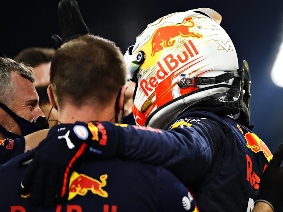 Max Verstappen and members of his Red Bull team celebrate their qualifying success in Abu Dhabi (Getty Images)