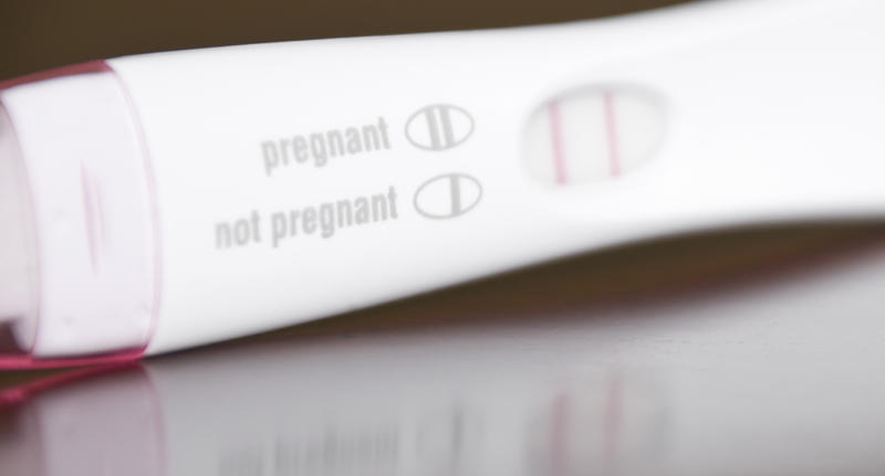 A positive pregnancy test.