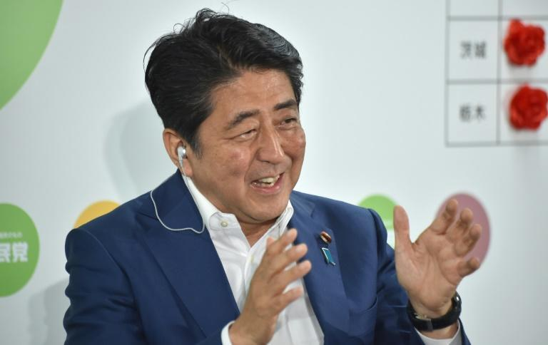 Voters handed Prime Minister Shinzo Abe's Liberal Democratic Party and its allies control of more than half of the upper house of parliament