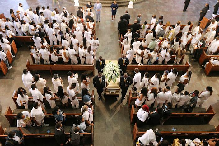 Rayshard Brooks' coffin is carried out of Ebenezer Baptist Church following his funeral in Atlanta on June 23. (Curtis Compton / Atlanta Journal-Constitution Pool)
