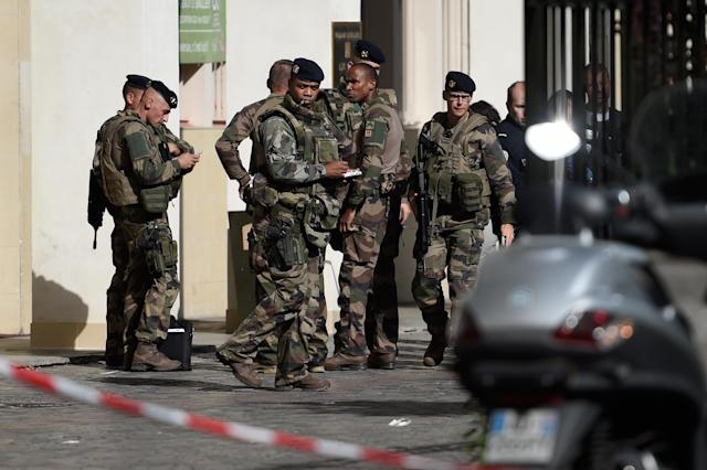 <p>French soldiers gather at the site where a car slammed into soldiers on patrol in Levallois-Perret, outside Paris, on August 9, 2017. (Photo: Stephane de Sakutin/AFP/Getty Images) </p>