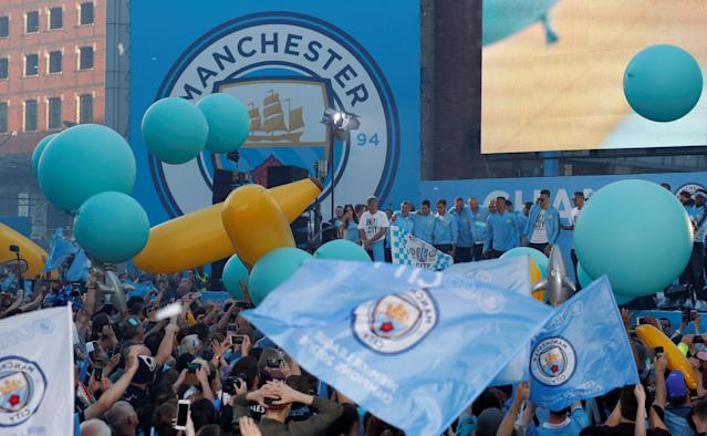 Soccer Football - Premier League - Manchester City Premier League Title Winners Parade - Manchester, Britain - May 14, 2018 Manchester City fans and players celebrate during the parade Action Images via Reuters/Andrew Boyers