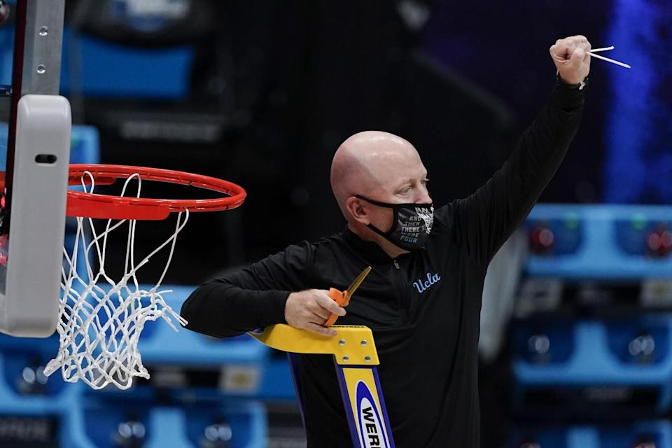UCLA coach Mick Cronin cuts down the net after the Bruins defeated Michigan on March 31.