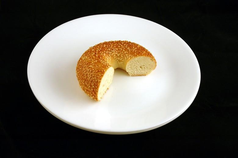 """<div class=""""caption-credit""""> Photo by: Wisegeek.com</div>About 2/3 of a sesame-seed bagel equals 200 calories -- and that's without butter or cream cheese. <br>"""