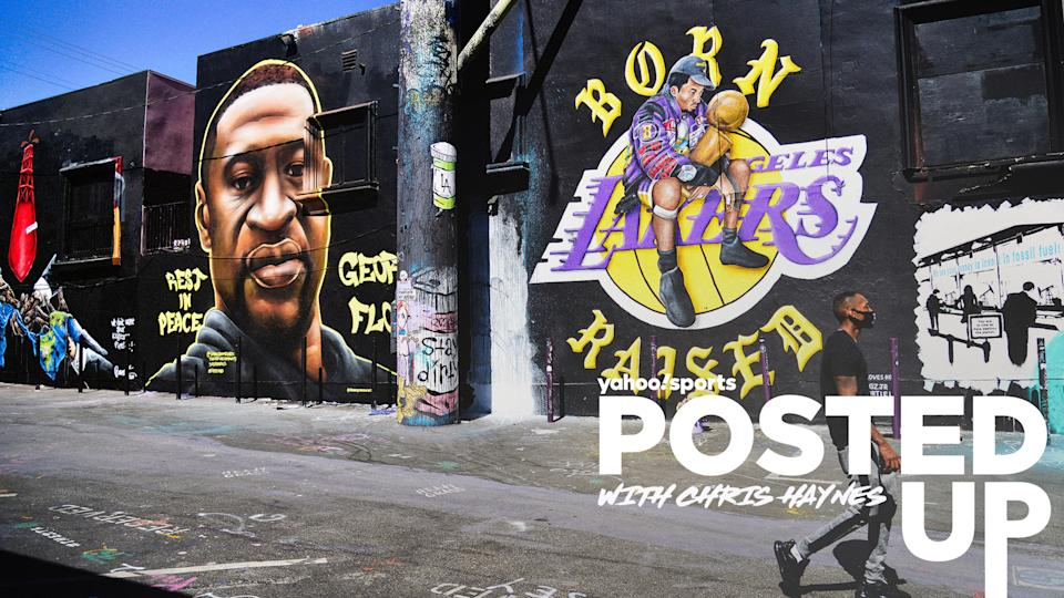 A graffiti mural of George Floyd appears alongside art depicting Kobe Bryant and the Los Angeles Lakers logo. (Photo by Chelsea Guglielmino/Getty Images)