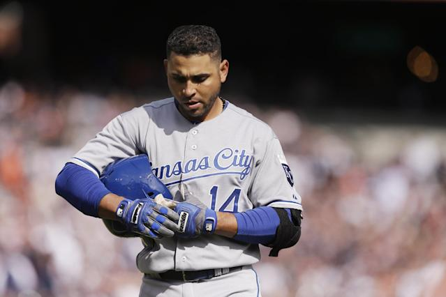 Kansas City Royals' Omar Infante walks back to the dugout after popping out during the ninth inning of a baseball game against the Detroit Tigers in Detroit, Monday, March 31, 2014. The Tigers defeated the Royals 4-3. (AP Photo/Carlos Osorio)