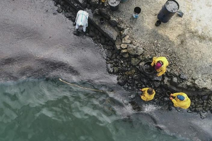 All-hands emergency: People scoop up oil at Bambous Virieux beach
