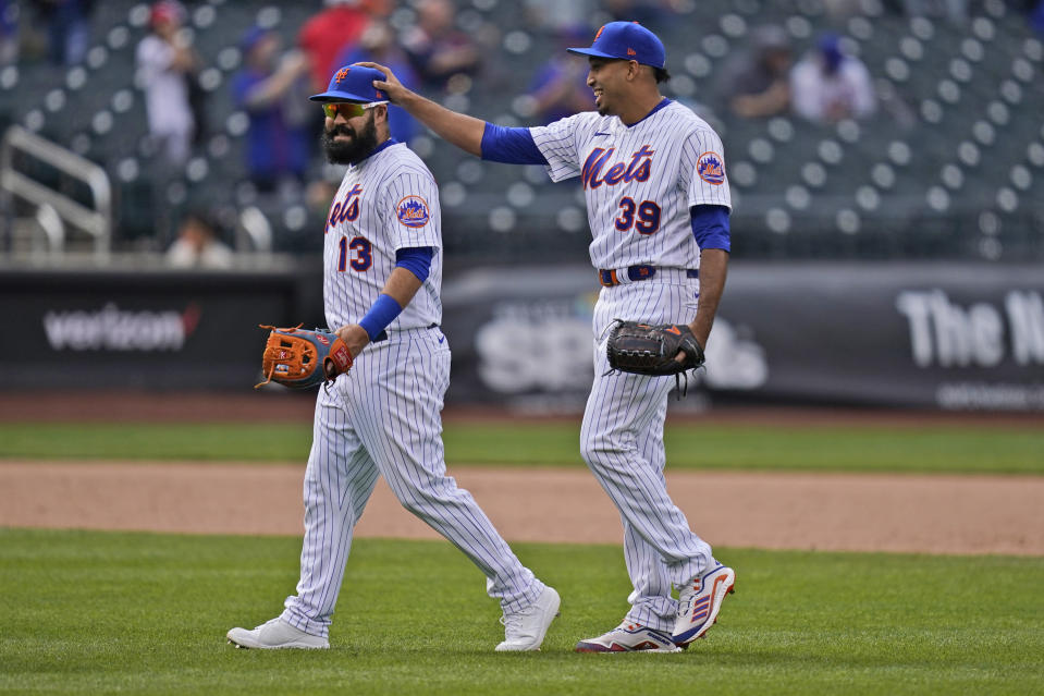 New York Mets relief pitcher Edwin Diaz, right, celebrates with Luis Guillorme after a baseball game against the Washington Nationals at Citi Field, Sunday, April 25, 2021, in New York. The Mets defeated the Nationals 4-0. (AP Photo/Seth Wenig)