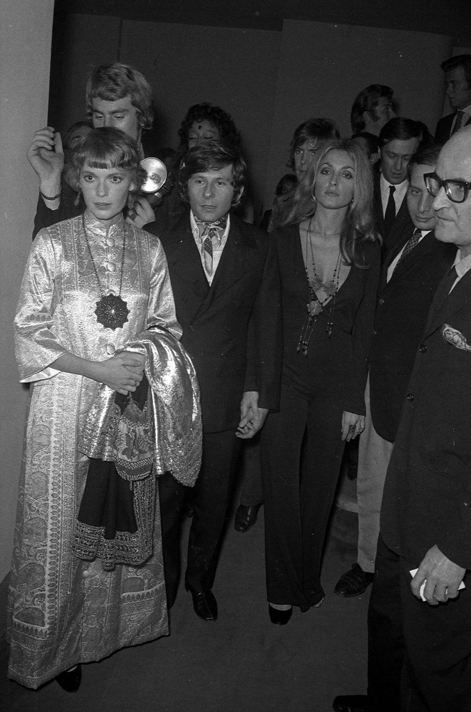 <p>Farrow poses with director Roman Polanski and his wife, actress Sharon Tate, at the premiere of <em>Rosemary's Baby</em> at the Cannes Film Festival. Polanski had originally envisioned Tate in the role of Rosemary Woodhouse<em>, </em>but Paramount decided to cast Farrow instead. </p>