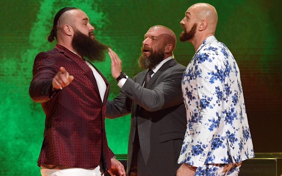 Tyson Fury (right) squares up to Braun Strowman - GETTY IMAGES
