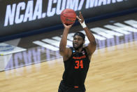 Oregon State forward Rodrigue Andela shoots during the first half of a Sweet 16 game against Loyola Chicago in the NCAA men's college basketball tournament at Bankers Life Fieldhouse, Saturday, March 27, 2021, in Indianapolis. (AP Photo/Darron Cummings)