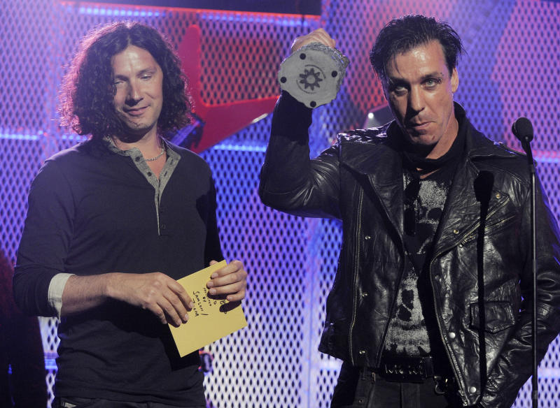 FILE - In this file photo dated Tuesday, April 20, 2011, members of German hard rock band Rammstein, with Till Lindemann, right, and Christoph Schneider accept the award for Best Live Band at the 3rd Annual Revolver Golden Gods Awards ceremony in Los Angeles, USA.  Jewish groups and the Israeli government on Thursday March 28, 2019, criticized Rammstein for a video promoting the release of its new single that features band members dressed as concentration camp inmates standing on a gallows.(AP Photo/Chris Pizzello, FILE)