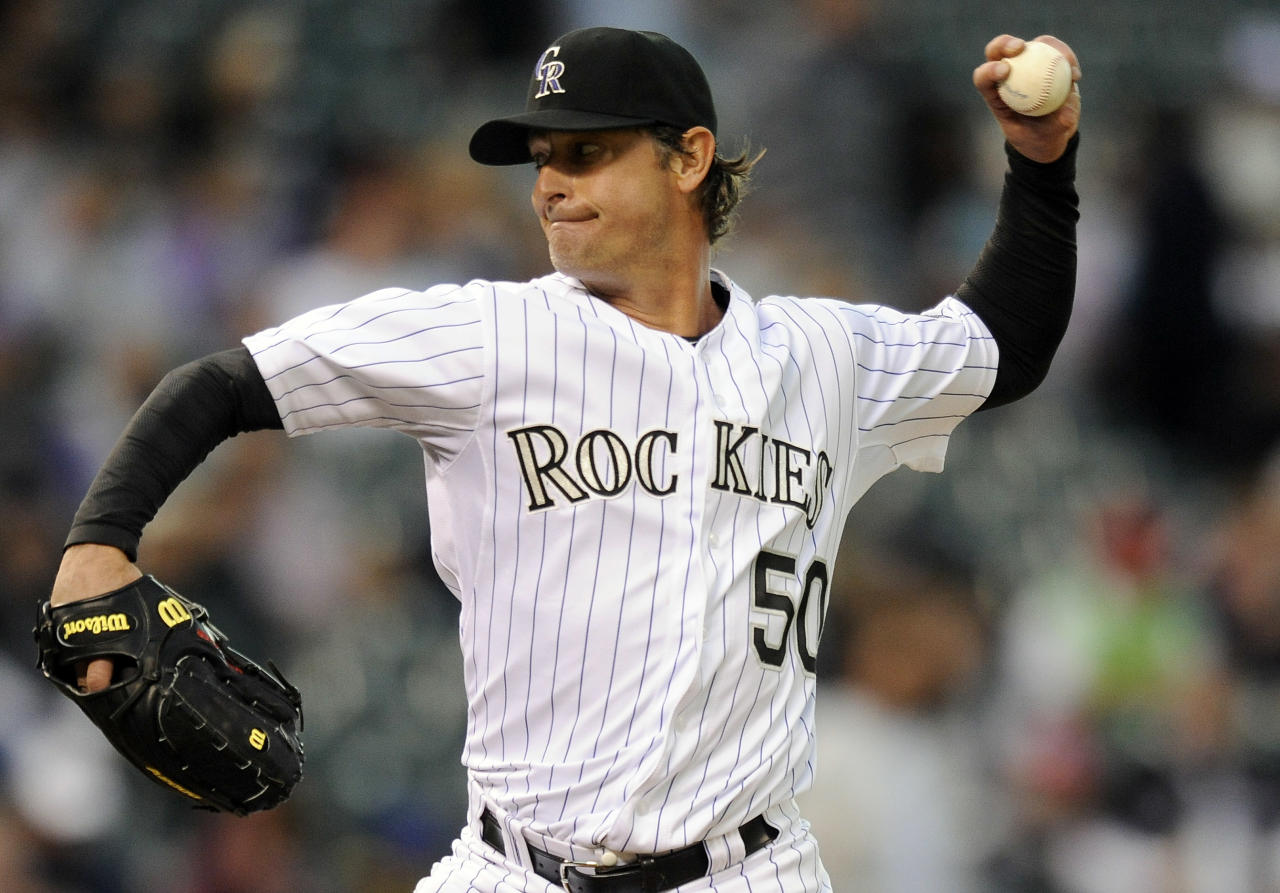 Colorado Rockies starting pitcher Jamie Moyer throws in the second inning of a baseball game against the San Diego Padres on Tuesday, April 17, 2012, in Denver. (AP Photo/Chris Schneider)