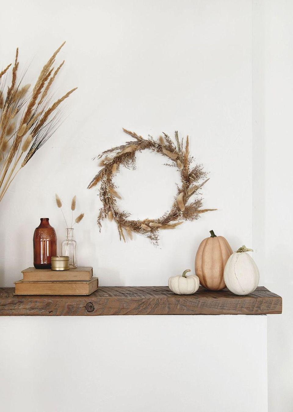 """<p>Dried florals and fall go together like pumpkins and patches! To capture that look, make this lovely dried grass wreath for your mantel.</p><p><strong>Get the tutorial at <a href=""""https://themerrythought.com/diy/diy-dried-grass-fall-wreath/"""" rel=""""nofollow noopener"""" target=""""_blank"""" data-ylk=""""slk:The Merrythought"""" class=""""link rapid-noclick-resp"""">The Merrythought</a>.</strong></p><p><a class=""""link rapid-noclick-resp"""" href=""""https://go.redirectingat.com?id=74968X1596630&url=https%3A%2F%2Fwww.walmart.com%2Fip%2FGorilla-Glue-Dual-Temp-Full-Size-Hot-Glue-Gun%2F210900389&sref=https%3A%2F%2Fwww.thepioneerwoman.com%2Fhome-lifestyle%2Fcrafts-diy%2Fg36891743%2Ffall-mantel-decorations%2F"""" rel=""""nofollow noopener"""" target=""""_blank"""" data-ylk=""""slk:SHOP HOT GLUE GUNS"""">SHOP HOT GLUE GUNS</a></p>"""