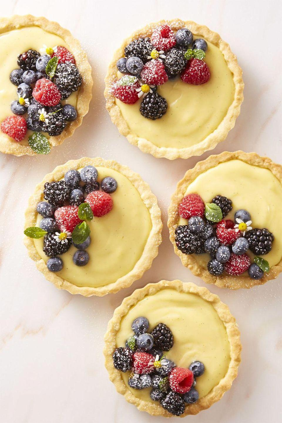"""<p>Toasted sliced almonds at the bottom of every tart give a surprising, crunchy contrast to each creamy bite. </p><p><em><a href=""""https://www.goodhousekeeping.com/food-recipes/dessert/a43667/very-berry-cream-tartlets-recipe/"""" rel=""""nofollow noopener"""" target=""""_blank"""" data-ylk=""""slk:Get the recipe for Very Berry Cream Tartlets »"""" class=""""link rapid-noclick-resp"""">Get the recipe for Very Berry Cream Tartlets »</a></em></p>"""