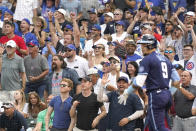 Fans celebrate after Chicago Cubs' Javier Baez hit a three-run home run during the first inning of a baseball game against the Arizona Diamondbacks in Chicago, Friday, July 23, 2021. (AP Photo/Nam Y. Huh)
