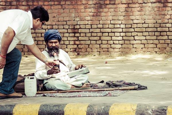 "<em>""Share a cricket score …share a smile"" </em><br><br>On the pavement outside <b>Bangla Sahib Gurudwara</b> in New Delhi sits a baba who is very fond of listening to cricket commentary and music on his radio. I spotted a young man handing him a cold drink to beat the heat, and then sit down and listen to the match commentary with him. All Baba needed was some company!"