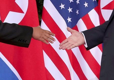 FILE PHOTO: U.S. President Donald Trump shakes hands with North Korean leader Kim Jong Un at the Capella Hotel on Sentosa island in Singapore