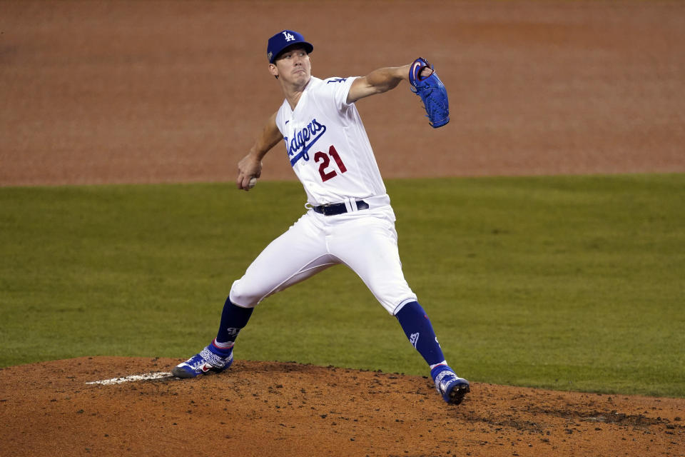 Los Angeles Dodgers starting pitcher Walker Buehler winds up during the third inning of Game 1 of the team's National League wild-card baseball series against the Milwaukee Brewers on Wednesday, Sept. 30, 2020, in Los Angeles. (AP Photo/Ashley Landis)