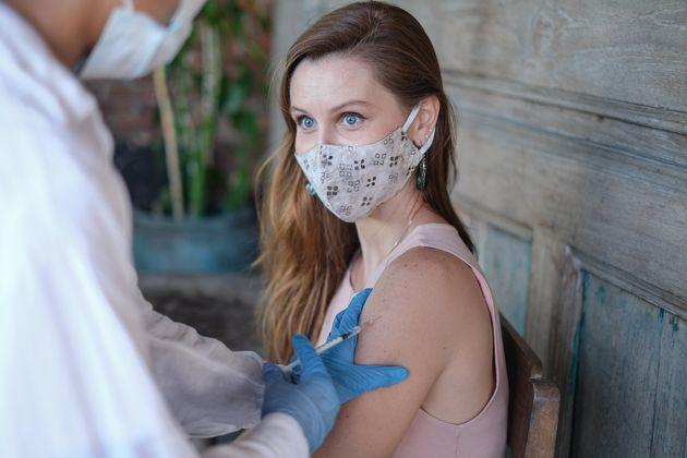 Close up shot of an unrecognizable healthcare worker with surgical mask injecting Covid-19 vaccine into Caucasian patient upper arms in Bali during Covid-19 delta variant rising. (Photo: Kanawa_Studio via Getty Images)