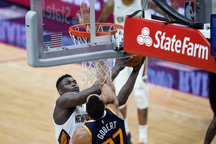 New Orleans Pelicans forward Zion Williamson shoots against Utah Jazz center Rudy Gobert in the first half of an NBA basketball game in New Orleans, Monday, March 1, 2021. (AP Photo/Gerald Herbert)