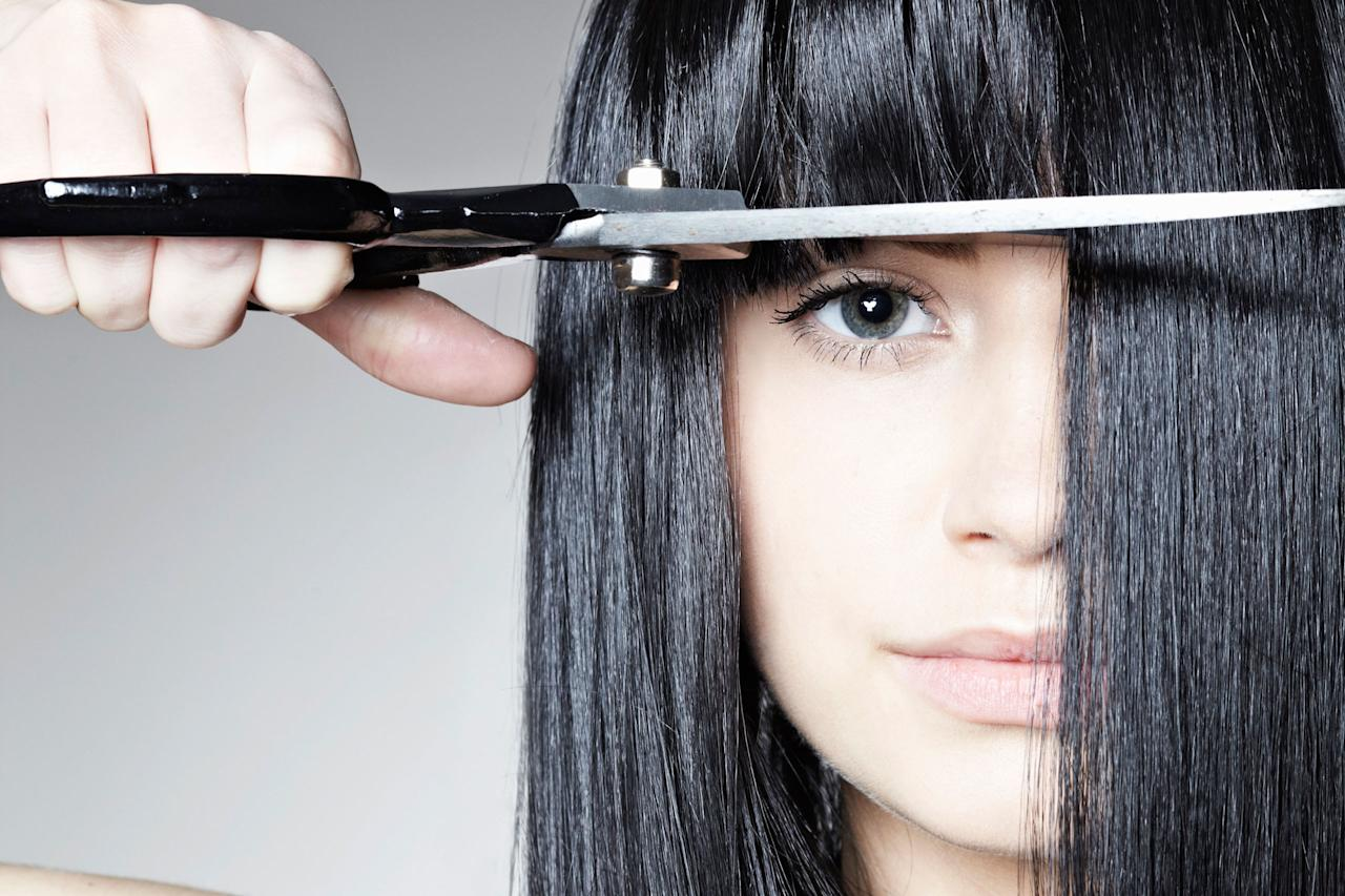 "<p>Finding time to head into the salon for a bang trim can be almost more difficult than the task itself. Luckily, with a little bit of faith, a steady hand, and the following key steps, an <a rel=""nofollow"" href=""http://www.redbookmag.com/beauty/hair/g3391/how-to-cut-bangs/"">at-home touch-up trim</a> is entirely possible to do yourself. </p><p><br></p><p>1.<strong> </strong>""Seeing how your hair falls naturally is key,"" explains celebrity hairstylist <a rel=""nofollow"" href=""https://www.instagram.com/jcmaciques/""><u>Juan Carlos Maciques</u></a>. ""Comb your bangs down right away after the shower and let them air-dry. This will allow cowlicks and those small sections of hair that fall in random directions pop up, therefore drying them to perfection or pulling them taught is a big no-no."" </p><p><span></span>2. Once hair has been dried naturally, Maciques recommends positioning your scissors vertically and cutting tiny sections of your bangs to the desired length without lifting them. This will leave a softer edge to your fringe, rather than a blunt line straight across that can occur when cutting horizontally.</p><p><br></p><p><strong>RELATED: <a rel=""nofollow"" href=""http://www.redbookmag.com/beauty/hair/tips/g2672/get-the-best-bangs-for-your-face/"">13 Ways to Get the Best Bangs for Your Face</a><span><a rel=""nofollow"" href=""http://www.redbookmag.com/beauty/hair/tips/g2672/get-the-best-bangs-for-your-face/""></a></span></strong><br></p>"