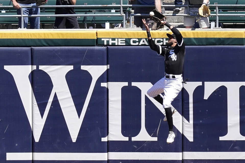Chicago White Sox's Billy Hamilton makes a leaping catch of Minnesota Twins' Kyle Garlick's deep fly ball with the bases loaded during the fourth inning of a baseball game Thursday, May 13, 2021, in Chicago. (AP Photo/Charles Rex Arbogast)