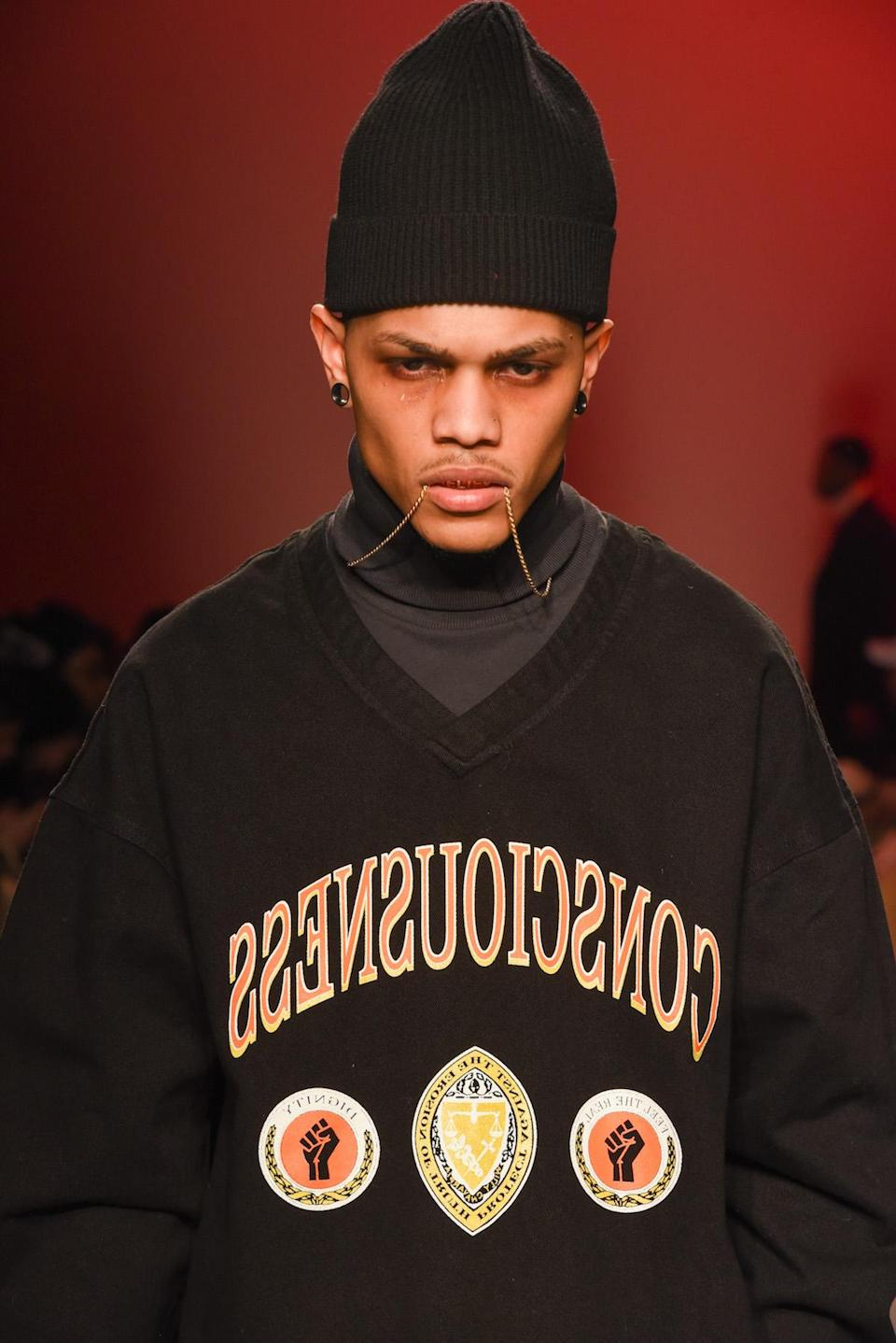 <p>A model in a sweatshirt on the runway at the Willy Chavarria show. (Photo: Getty Images) </p>