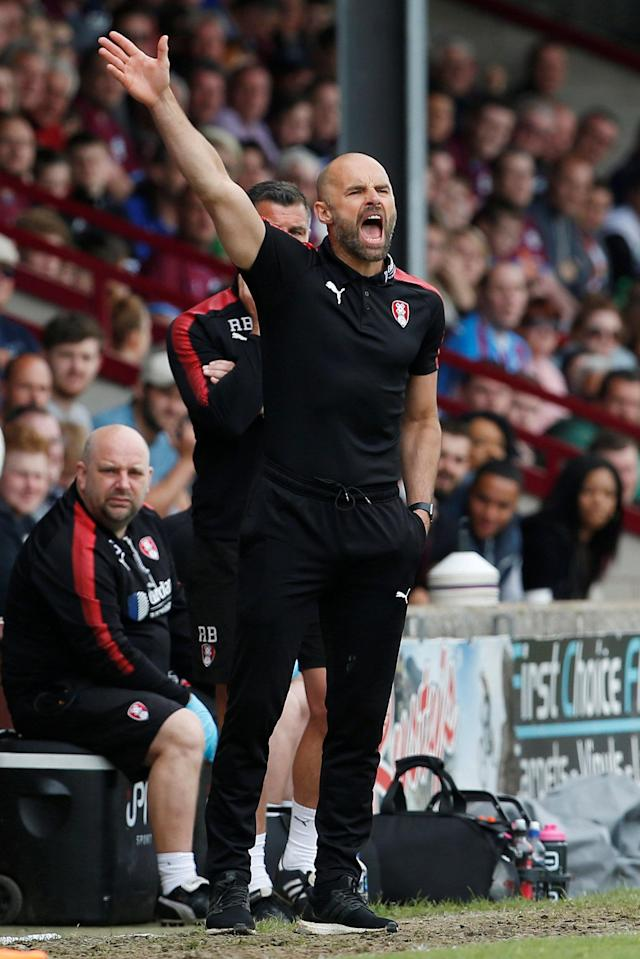 "Soccer Football - League One Play Off Semi Final First Leg - Scunthorpe United v Rotherham United - Glanford Park, Scunthorpe, Britain - May 12, 2018 Rotherham United manager Paul Warne reacts Action Images/Craig Brough EDITORIAL USE ONLY. No use with unauthorized audio, video, data, fixture lists, club/league logos or ""live"" services. Online in-match use limited to 75 images, no video emulation. No use in betting, games or single club/league/player publications. Please contact your account representative for further details."