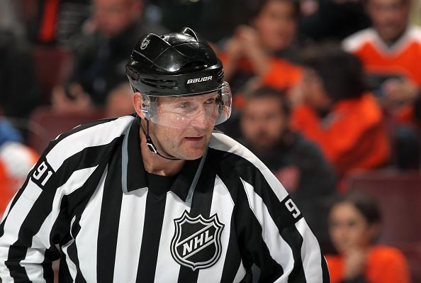 PHILADELPHIA, PA - DECEMBER 15: Linesman Don Henderson #91 looks on during a game between the Philadelphia Flyers and the Carolina Hurricanes on December 15, 2015 at the Wells Fargo Center in Philadelphia, Pennsylvania. (Photo by Len Redkoles/NHLI via Getty Images)