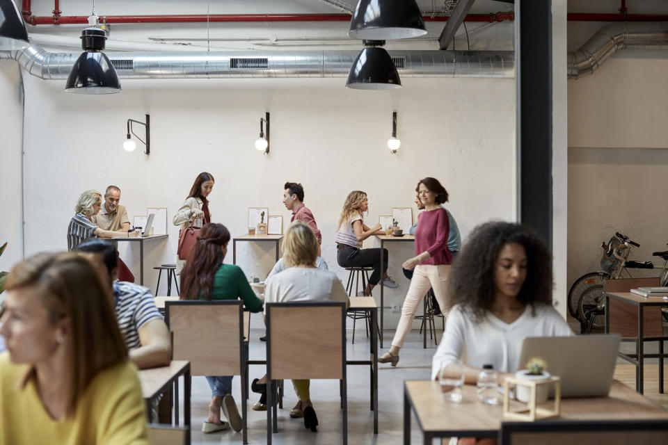 There seems to be as many laptops as there are coffee cups at some cafes these days. <em>(Photo: Getty)</em>