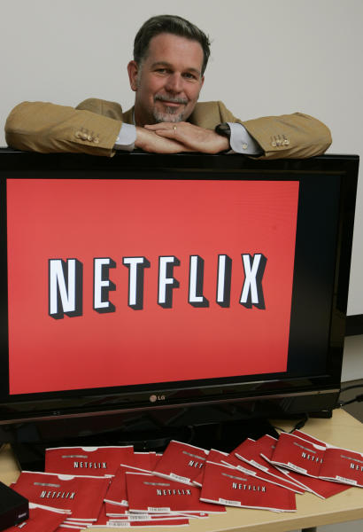 "FILE - O this July 25, 2008, file photo, Netflix CEO Reed Hastings poses for a photo at Netflix headquarters in Los Gatos, Calif. A new book,""Netflixed: The Epic Battle for America's Eyeballs,"" is set to go on sale Thursday, Oct. 11, 2012. The book tries to debunk a widely told tale about the company's origins and paints a polarizing portrait of its star CEO Reed Hastings. (AP Photo/Paul Sakuma)"